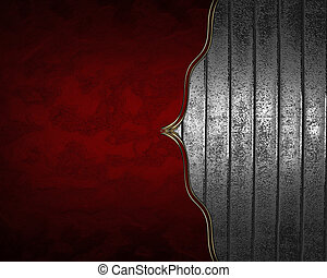 Red background with iron background with gold trim. Design...