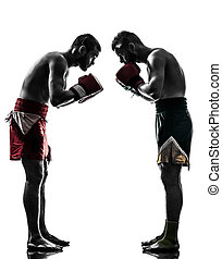 two men exercising thai boxing salute silhouette - two...