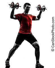 man exercising weight training silhouette - one caucasian...