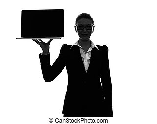 business woman holding showing computer laptop  silhouette
