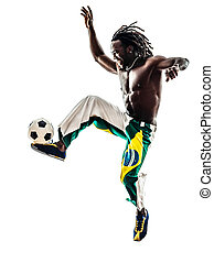 brazilian black man soccer player juggling football - one...