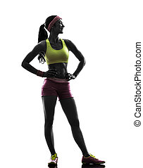 woman exercising fitness standing looking away silhouette -...
