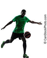 african man soccer player kicking silhouette - one african...