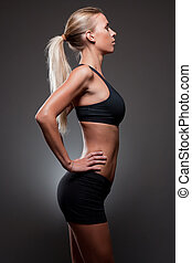 Slender fit beauty. - Portrait of very fit young slender...