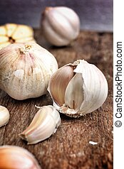 Garlic on the brown wood background