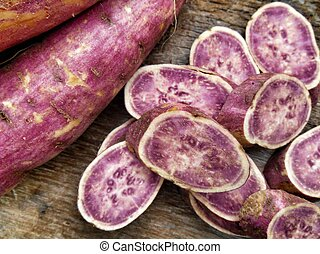 Sweet potato on wood background