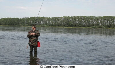 Fishing - Fisherman catches a fish on a spinning