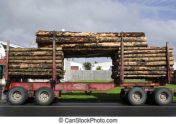 Logging Truck - KAITAIA, NZ - AUG 29:Stacked wooden logs,...