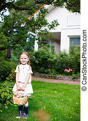 Little girl with apples - Happy little girl with a basket of...