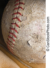 well-used softball in mitt - well-used softball with red...