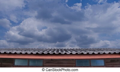 Moving Cloud Over the Tile Roof - The Timelapse of soft...