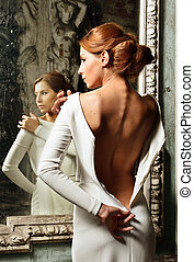beautiful woman in white dress with naked back. - Portrait...