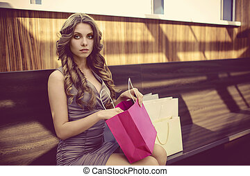 Young girl with bags for shopping