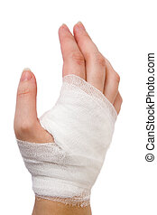 Bandage - The injured hand of the girl tied up by white...