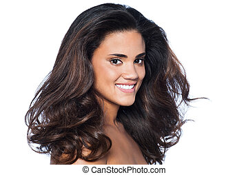 Woman with long healthy and shiny wavy hair