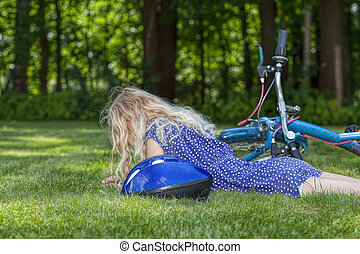 Child fallen down of bike - Child falen down of a bike next...