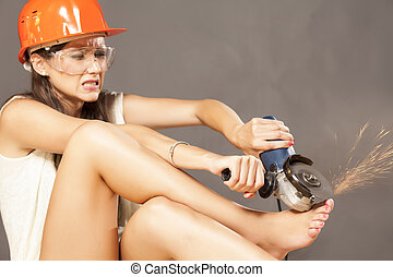 bizzare pedicure - girl with helmet and goggles polished her...