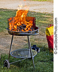 barbecue gril outdoor - Portable barbecue grill with burning...