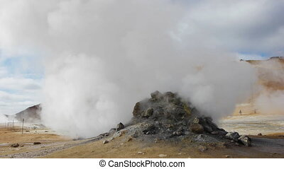 mini volcano steams - field of mud pools and fumaroles at...