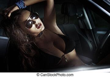 Portrait of sexy brunette in sport car. - Portrait of...