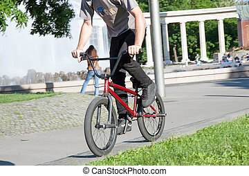 Bmx - Young guy is riding a bmx bike