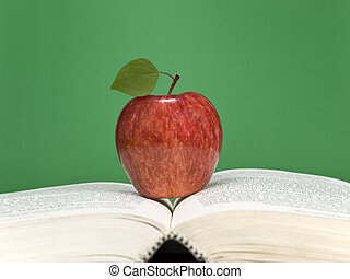 Healthy learning - A red apple over an open book Blank...