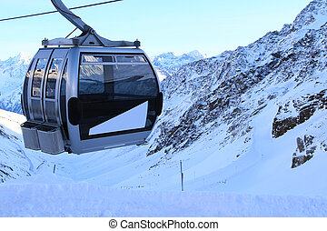 Chairlift in mountains - Chairlift in winter mountains at...