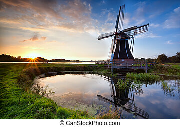 charming Dutch windmill at sunset - charming Dutch windmill...