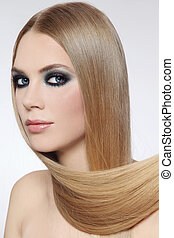 Hair care - Portrait of young beautiful woman with long fair...