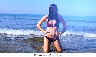 Woman in bikini having fun