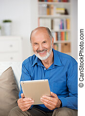Elderly man holding a tablet-pc - Attractive smiling elderly...