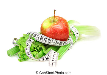 Celery apple and measure tape diet concept isolated on white