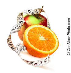 Orange half apple and measure tape - Orange half apple and...