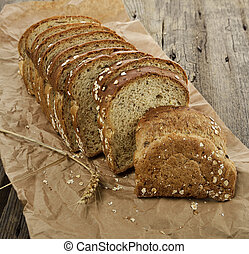 Sliced Brown Wholewheat Bread On A Wooden Surface