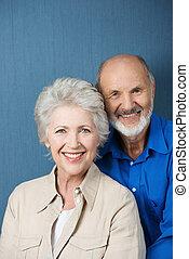 Friendly smiling senior couple