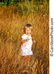Girl and wheat ears - Blonde girl walking through the ears...