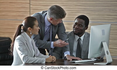 Team of interns - Mature businessman mentoring his interns