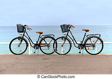 Two bikes on the beach in Nice, France