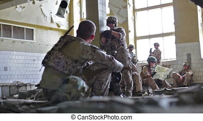 Soldiers at leisure - Soldiers having a rest in an abandoned...