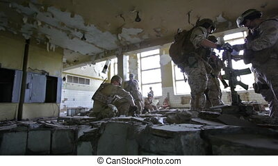 Shelter - Militaries resting in a derelict shelter before...