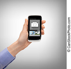 hand with smartphone showing application - business, future...