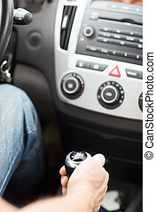 man shifting the gear on car manual gearbox - transportation...