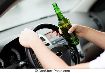 man drinking alcohol while driving the car - transportation...