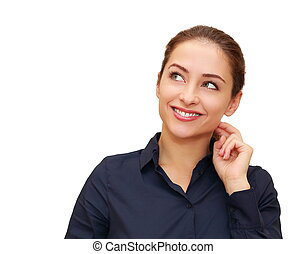 Smiling thinking business woman with hand at face looking on...