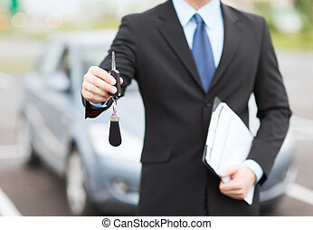 man with car key outside - transportation and ownership...