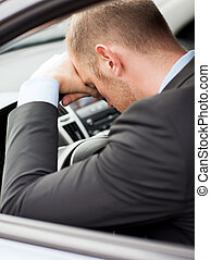 tired businessman or taxi car driver - transportation and...