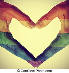 gay love - picture of man hands forming a hear patterned...