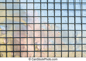 metal grid with mirroring surface in background
