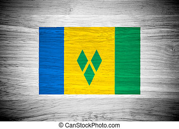 Saint Vincent and the Grenadines flag on wood texture