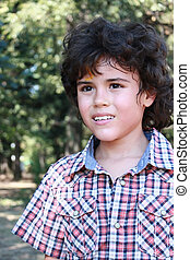 Handsome boy - Outdoor portrait of a handsome boy with long...